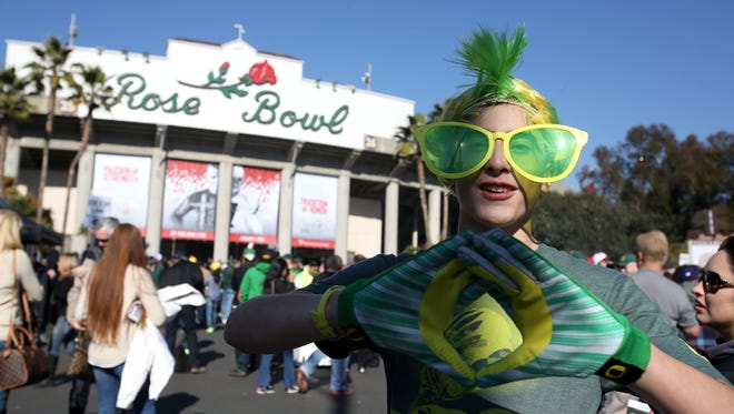 Duck fan Ivan Garibay, 14, of Tualitin poses for a photo as he makes his way into the Rose Bowl stadium on Thursday, Jan. 1, 2015, Pasadena, Calif.