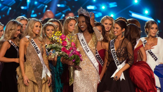 Miss District of Columbia Deshauna Barber smiles after being crowned Miss USA during the 2016 Miss USA pageant in Las Vegas, Sunday, June 5, 2016.
