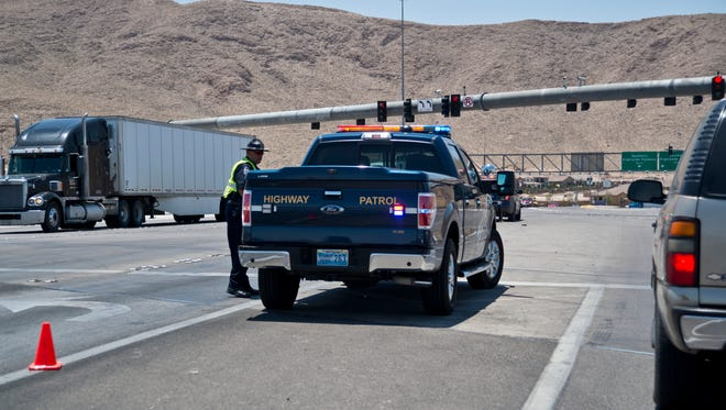 A police vehicle blocks the entrance to Interstate 15 at St. Rose Parkway in southeast Las Vegas, Wednesday, June 22, 2016. authorities said Wednesday that passengers have been evacuated and one person has been arrested after someone reported a bomb aboard the bus. Interstate 15 was briefly shut down in both directions from St. Rose Parkway to Sloan.