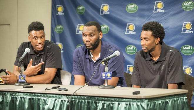 Thaddeus Young (left), Al Jefferson, and Jeremy Evans, at a press conference to announce new players, Bankers Life Fieldhouse, Indianapolis, Friday, July 8, 2016.