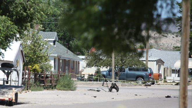 Shrapnel from a Wednesday night bombing that killed one person sits on a street in Panaca, Nev., on Thursday, July 14, 2016.