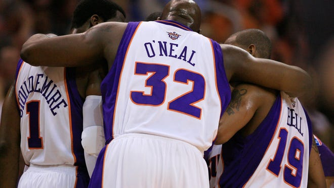Shaquille O'Neal in the team huddle with then-Suns teammates Raja Bell  and Amare Stoudemire before a first-round playoff game in 2008.