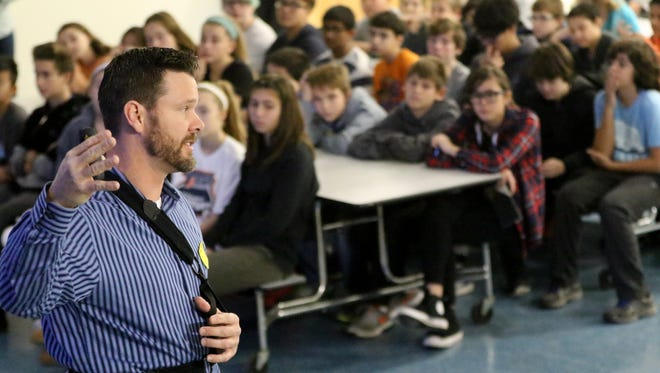Det. Sgt. Chad Malloy of the Woodcliff Lake Police Department spoke to approximately 78 seventh-grade students at Norwood Public School Monday about cyber safety. Monday, November 28, 2016.