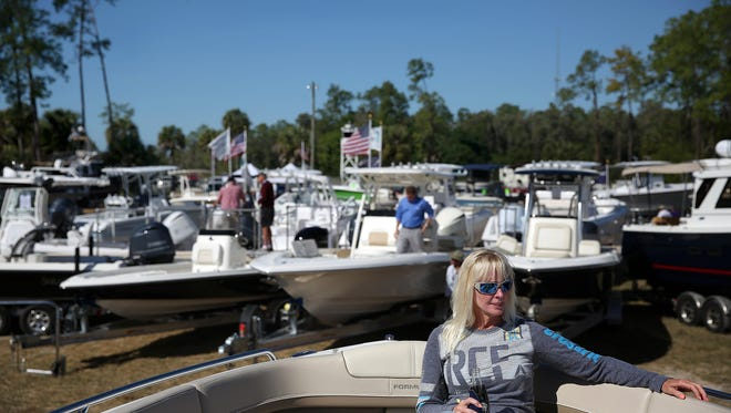 Kelly Gilbert, of Michigan, tests out the seats in a boat while at the Naples Boat Show on January 29, 2015.