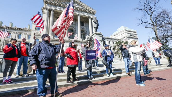 Trump supporters rally at the Indiana Statehouse during the March 4 Trump rally in Indianapolis, March 4, 2017. Thirty five to forty Trump supporters took part in the event.