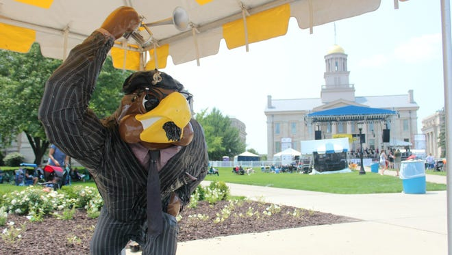 Jazz-themed Herky statues, part of two previous Herky on Parade series, appeared near the main stage at the Iowa City Jazz Festival July 3, 2015.