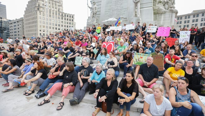 The crowd takes a seat on the steps at the Soldiers and Sailors Monument during the Sit-in Vigil in Solidarity with Charlottesville held on Monument Circle in downtown Indianapolis on Sunday, August 13, 2017.