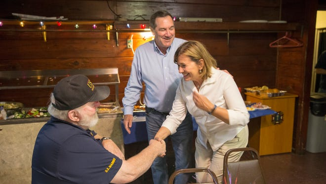 USMC veteran John Baker visits with Jill Donnelly, whose husband Joe is running to retain his U.S. Senate seat, VFW Speedway Post 2839, Sunday, August 20, 2017.