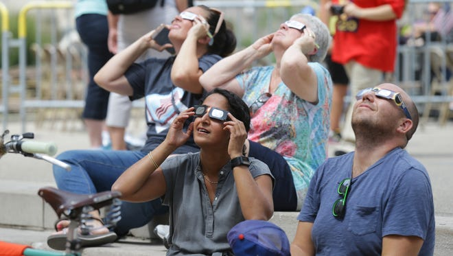 A group views the eclipse on Monument Circle in Indianapolis Monday, August 21, 2017.