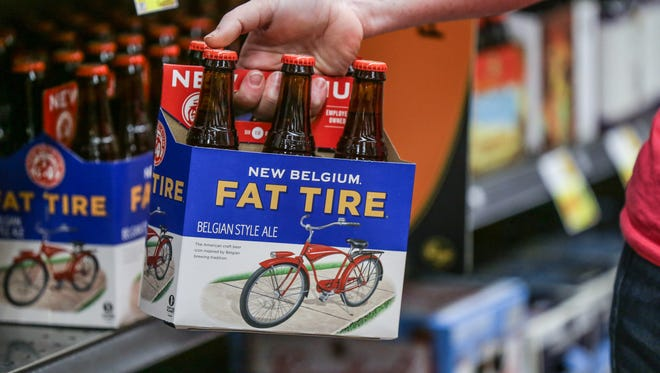 A customer picks up a six pack of Fat Tire beer at the Kroger, 1217 S. Rangeline Rd. in Carmel Ind. on Monday, Oct. 9, 2017.