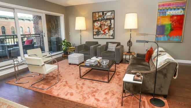 An open living room welcomes guests at the downtown Indianapolis home of Steve Hamilton, Interim CEO Indianapolis Symphony Orchestra and his husband Keith Norwalk, President of Crown Hill Funeral Home and Cemetery on Monday, Oct. 10, 2017.