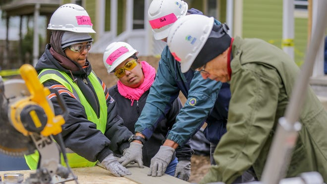 Left to right, Future Habitat homeowners Tammy Taylor and Blanca Verganzo work with volunteers Bob Koor, and Loren Zimmerman during the annual Habitat for Humanity interfaith build in Indianapolis on Sunday, Oct. 29, 2017. Volunteers from Congregation Beth-El Zedeck, the Muslim Alliance of Indiana and the Indianapolis Hebrew Congregation joined forces for the build day.