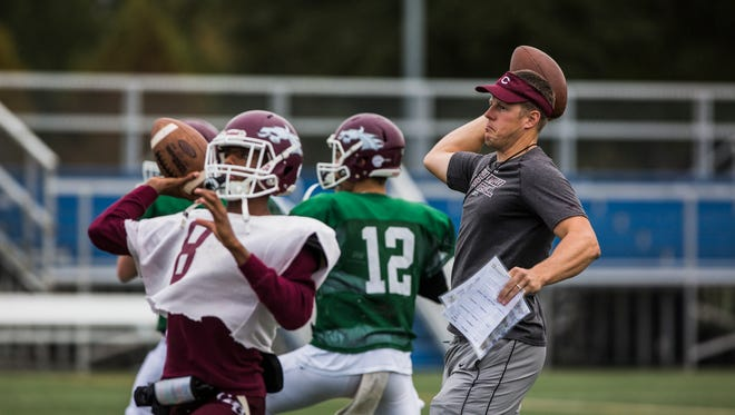 November 1, 2017 - Tommy Miller, interim coach for Collierville High School, throws the ball during football practice at Johnson Park in Collierville on Wednesday. The team is competing in a playoff game without coach Mike O'Neill, who has resigned in order to begin cancer treatments.