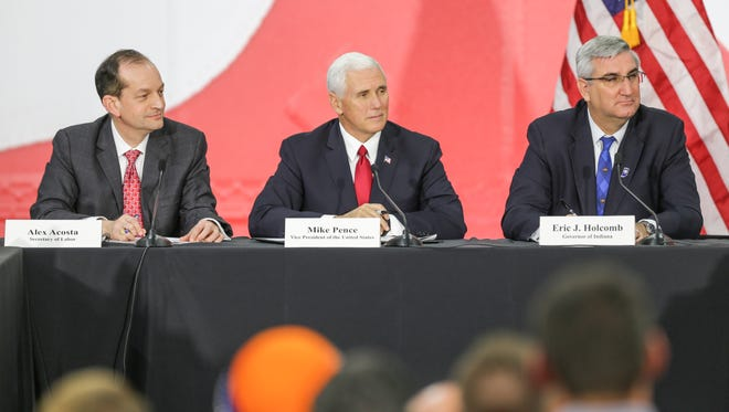Secretary of Labor Alex Acosta, left, Vice President of the United States Mike Pence, center, and Ind. Governor Eric Holcolmb, right, take part in a round table tax discussion during a visit to TKO Graphix in Plainfield Ind. on Thursday, Nov. 9, 2017.