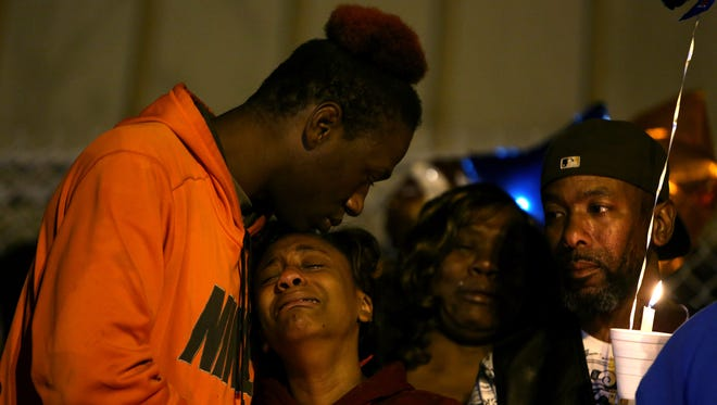 November 14, 2017 - Chartia Finley, 25, holds Dijonnaise Jordan, 16, as they mourn their 10-year-old brother, Richard Jordan III, during a vigil in his honor at the Riverview Community Center on Tuesday. Jordan was killed Monday during a drive-by shooting at the intersection of Airways and Ketchum.