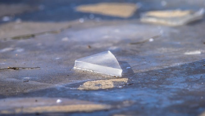 A triangle of ice lays atop a frozen section of the White River in Broad Ripple Park in Indianapolis on Thursday, Dec. 28, 2017.