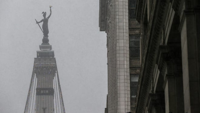 The monument is barely visible as snow falls in Indianapolis on Friday, Dec. 29, 2017.