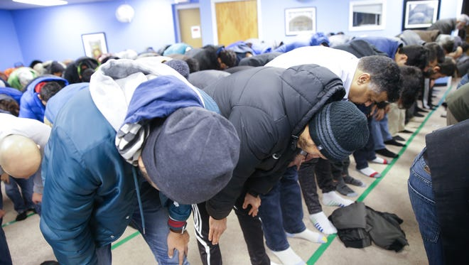 Worshipers bow in prayer during Friday prayer services at Al Salam Foundation worship center in Indianapolis on Friday, Jan. 5, 2018.