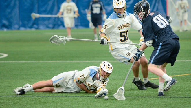 Marquette senior midfielder Colin Riehl reaches for the ball as he, teammate Noah Richard and Villanova's Colin Hunt scramble to control it in a Big East Conference men's lacrosse game on March 31 at Valley Fields.