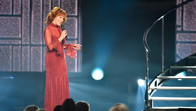 Host Reba McEntire performs during the 53rd Academy of Country Music Awards at the MGM Grand Garden Arena Sunday, April 15, 2018, in Las Vegas.