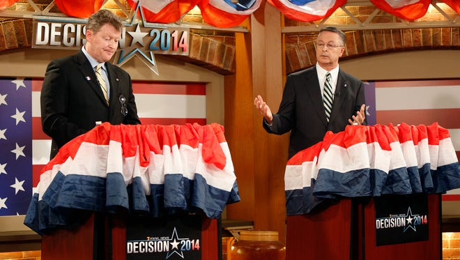 1st District congressional Democratic candidate Pat Murphy, left, listens as Republican candidate Rod Blum, right, gives his opening statement during the second and final debate in the KWWL news studio, Saturday, Oct. 18, 2014, in Waterloo, Iowa. (AP Photo/Waterloo Courier, Matthew Putney)