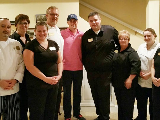 Jordan Spieth poses with the dining services staff at Lakeland College after having dinner at the school Saturday night.