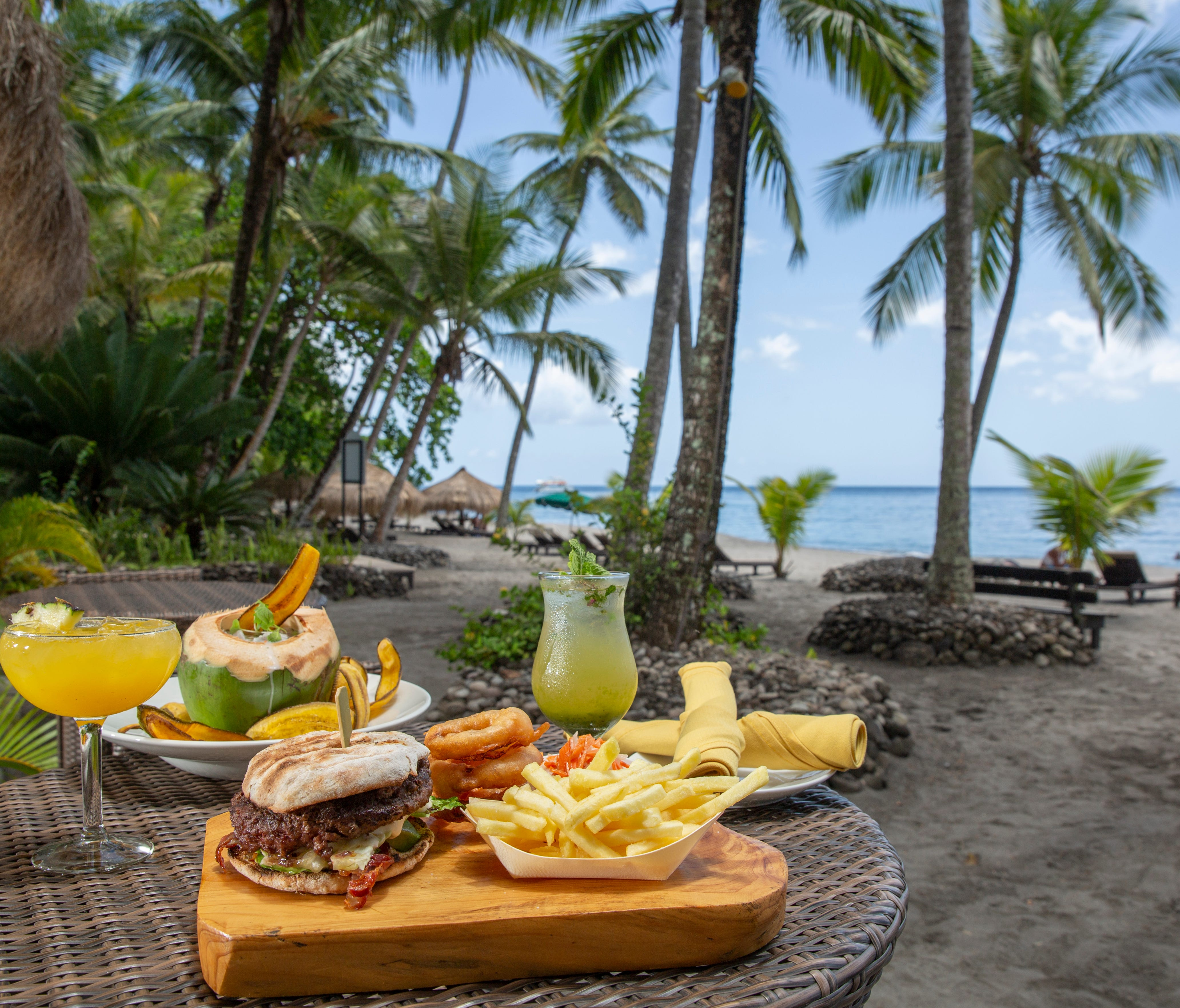 At the Jungle Grill in St. Lucia, minty mojitos and burgers are the star attractions.