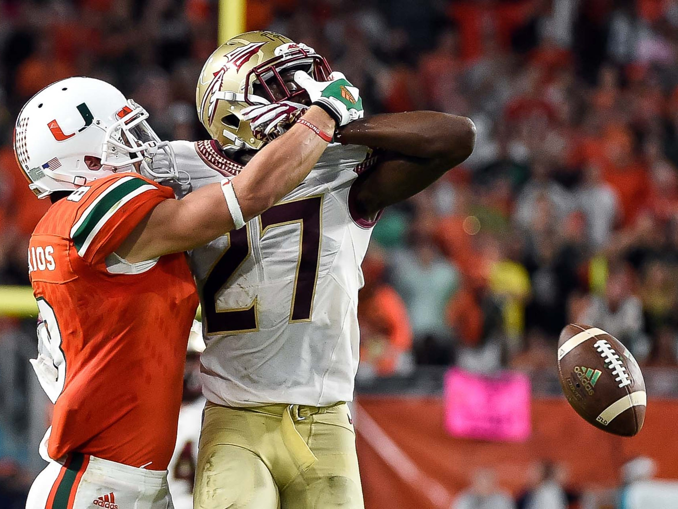 Marquez White defends a pass intended for Miami's Braxton Berrios.