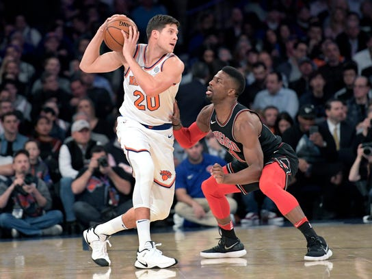 FILE - In this Jan. 10, 2018, file photo, New York Knicks forward Doug McDermott (20) protects the ball as he is guarded by Chicago Bulls guard David Nwaba (11) during the first quarter of an NBA basketball game at Madison Square Garden in New York. Two people with knowledge of the situation say the Denver Nuggets have traded Emmanuel Mudiay to New York and acquired Devin Harris from Dallas in a three-team deal. The Mavericks will get Doug McDermott from New York, the people told The Associated Press on Thursday, Feb. 8, 2018. They spoke on condition of anonymity because the trade could not be completed until it was approved by the NBA. (AP Photo/Bill Kostroun, File)