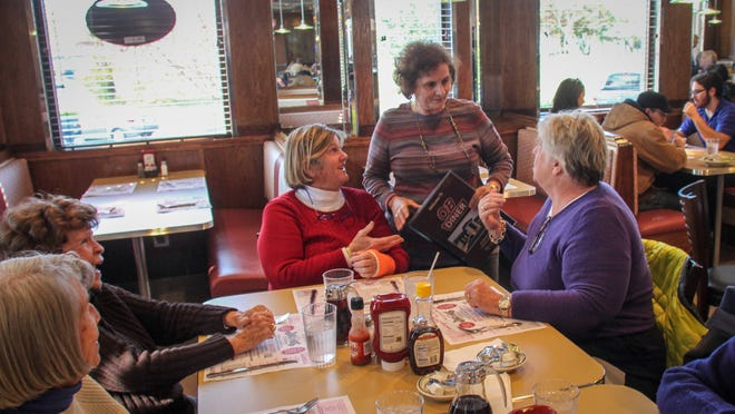 Irene Antonatos, one of the new owners of the OB Diner in Point Pleasant, talks with customers Anne Kennard (left) and Gail Houston, both of Point Pleasant.