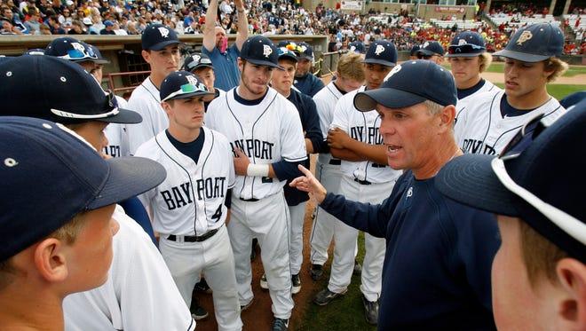 Bay Port High School's head coach Mike Simoens talks to his team as the get ready to play against Sun Prairie High School during their WIAA Division 1 state baseball championship game.