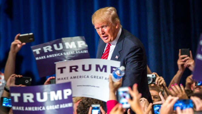 Donald Trump addresses supporters during a rally at the Phoenix Convention Center on July 11, 2015.