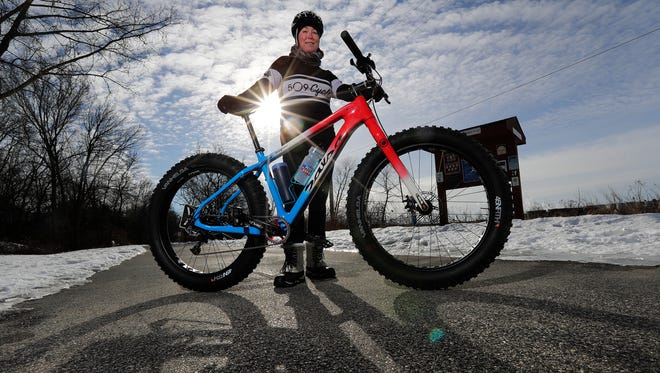 Heather Gentry, president of the Green Bay Bicycle Collective, is the Green Bay Press-Gazette's Person of the Year for 2016. Gentry is shown on the Fox River Trail on Friday, December 30, 2016, in Green Bay, Wis.