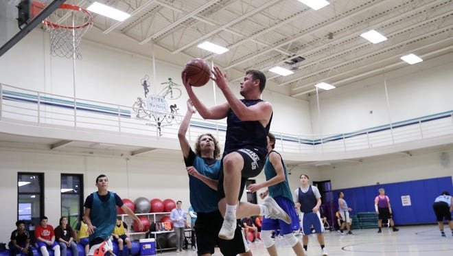 Students play in a 3-on-3 intramural basketball tournament on campus at Northeast Wisconsin Technical College on Thursday, October 12, 2017 in Green Bay, Wis.