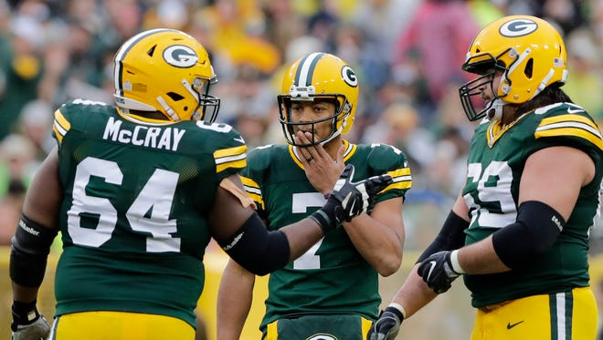 Green Bay Packers quarterback Brett Hundley (7) talks with guard Justin McCray (64) and tackle David Bakhtiari (69) in the third quarter against the New Orleans Saints at Lambeau Field on Oct. 22, 2017.