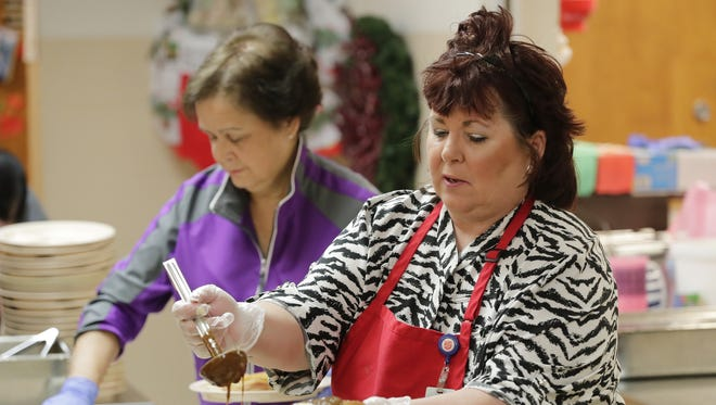 Barb Bonifas serves the New Years lunch for those in need at the Salvation Army on Friday, December 29, 2017 in Green Bay, Wis. Adam Wesley/USA TODAY NETWORK-Wisconsin