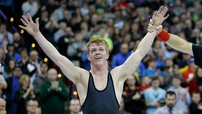 Stratford's Jeremy Schoenherr celebrates his historic fourth state championship after defeating Coleman's Jake Baldwin for the Division 3 138-pound title match at the WIAA individual state wrestling tournament at the Kohl Center in Madison.