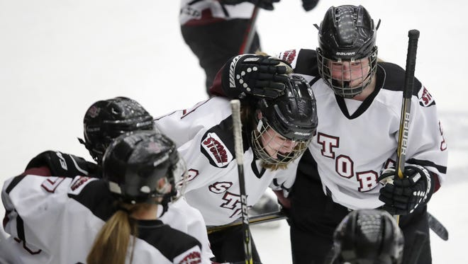 Central Wisconsin Storm's Audrey Ladewig, right, puts her arm around teammate Kenna Bailey after a 5-2 loss to Eau Claire Area in a WIAA girls hockey state semifinal on Friday at Veterans Memorial Coliseum.