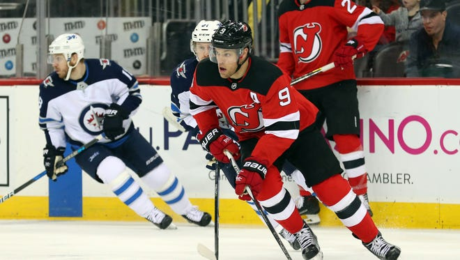 New Jersey Devils left wing Taylor Hall (9) skates with the puck during the first period of their game against the Winnipeg Jets at Prudential Center.