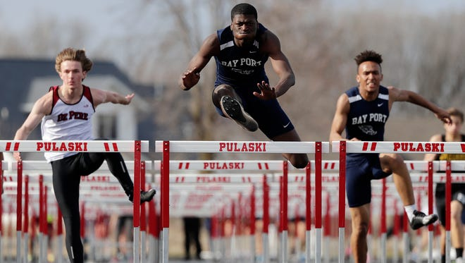 Bay Port's Cordell Tinch wins the 110-meter hurdles April 26 at the Red Raider Invitational track meet at Pulaski High School.