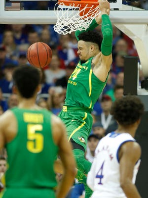 Oregon Ducks forward Dillon Brooks (24) dunks during the first half against the Kansas Jayhawks in the finals of the Midwest Regional of the 2017 NCAA Tournament at Sprint Center.