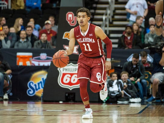 Oklahoma's Trae Young is a point guard option for the Knicks to draft. Young leads the nation in scoring and assists.