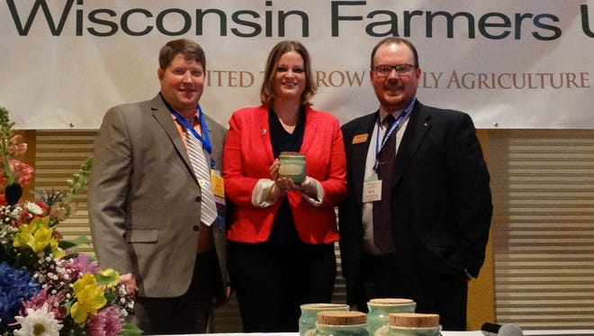 State Rep. Katrina Shankland accepts a Friend of the Family Farmer award from Wisconsin Farmers Union President Darin Von Ruden, left, and WFU Government Relations Director Nick Levendofsky.