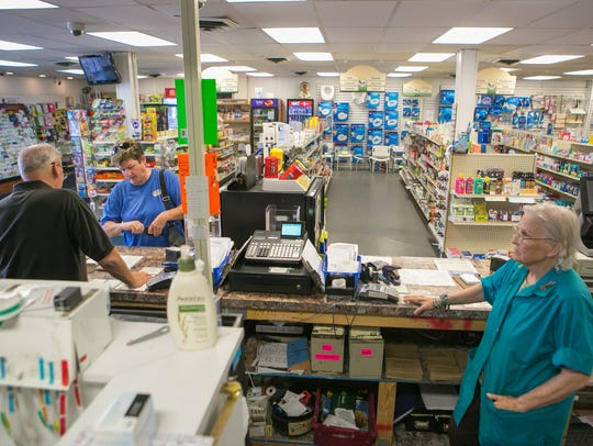 Manor Pharmacy clerks Kerry Hoopes (left) and Shirley