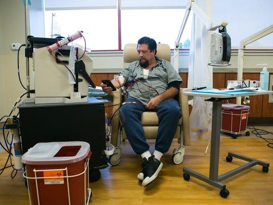 Dave Amalfitano, 47, gets a dialysis treatment at Fresenius