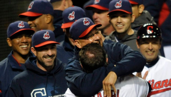 Jason Giambi celebrates with manager Terry Francona after hitting a game-winning two-run home run in the ninth inning Tuesday.