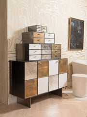 Burnished bronze adds luster to this cabinet by Kelly Wearstler.