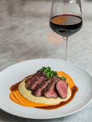 Grilled wagyu beef culotte, potato puree, kale romesco and beef jus from Salazar OTR.