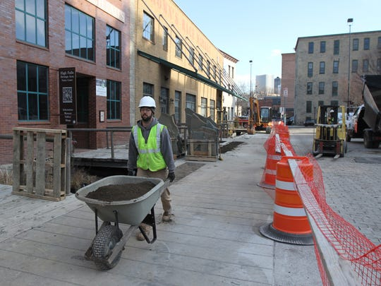 FlourGarden is an urban greenway being built by Greentopia in High Falls.  Nick Snyder with Broccolo Tree & Lawn Care fills in areas with dirt.