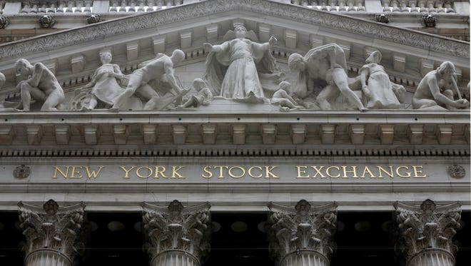 This Oct. 4, 2014, photo shows the facade of the New York Stock Exchange.  (AP Photo/Richard Drew, File)
